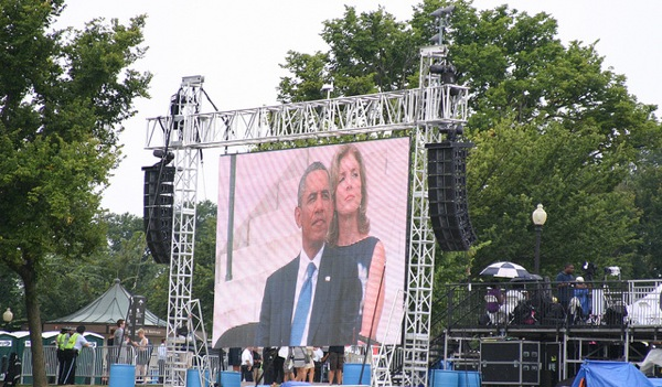 President Barack Obama seen on a screen at the 50th Anniversary of the March on Washington.