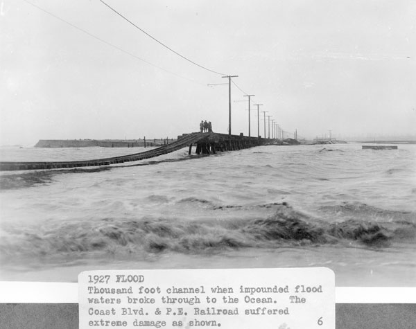 The mouth of a swollen Santa Ana River near Newport Beach and Huntington Beach, 1927. Courtesy of the Orange County Archives.