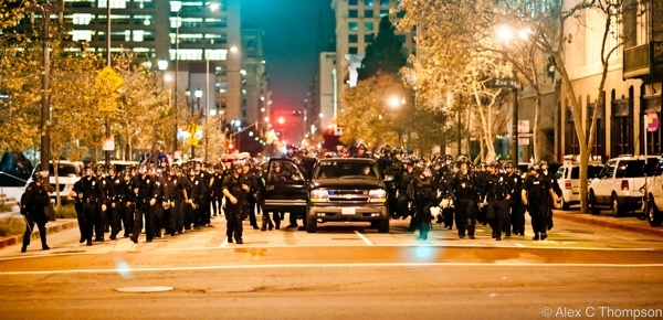 LAPD officers approach city hall to evict Occupy L.A. protesters | Photo by Alex Thompson