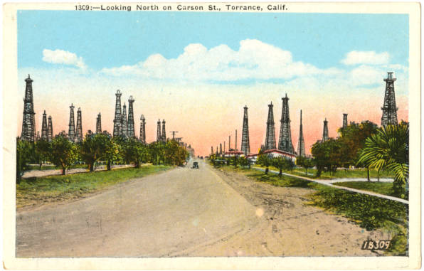 Circa 1920s postcard of oil wells along Carson Street in Torrance. Courtesy of the South Bay History Collection, Cal State Dominguez Hills Archives.