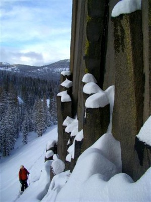 A skier at the base of the Postpile | Photo courtesy National Park Service
