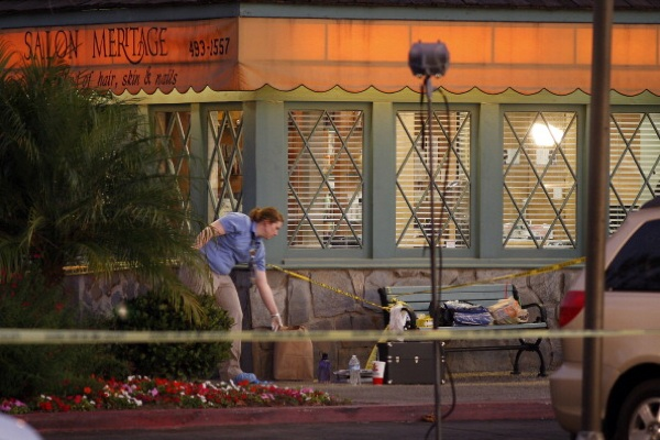 Investigators collect evidence at Salon Meritage hair salon where a man shot nine people, killing eight of them, on October 12, 2011 in Seal Beach | Photo by David McNew/Getty Images