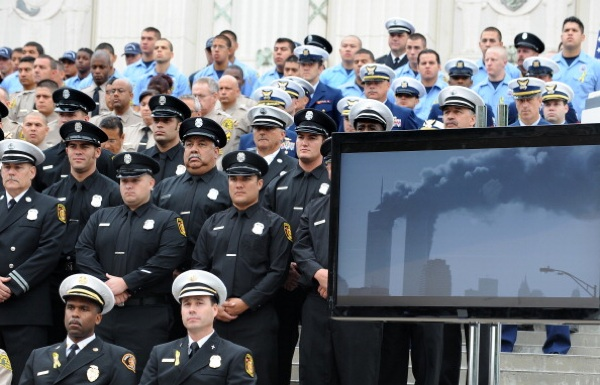 Members of the Los Angeles Fire Department and guests watch a video presentation recounting the events of  9/11 | Photo: ROBYN BECK/AFP/Getty Images