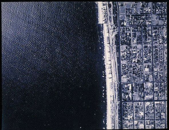 This 1931 aerial view of Santa Monica shows the shoreline reflected in the city's street grid. Courtesy of the Santa Monica Public Library Image Archives.