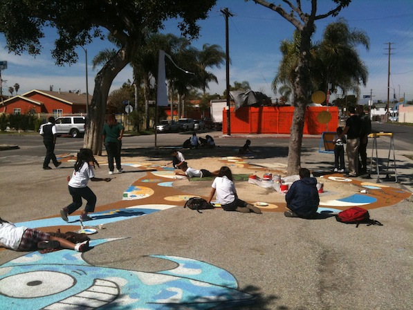 Students create temporary chalk art drawings before concrete is taken out |  Photo by Zach Behrens/KCET