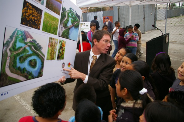 Gary Lee Moore shows area children the full vision of the wetlands at the groundbreaking in 2010 | Photo by Ed Fuentes