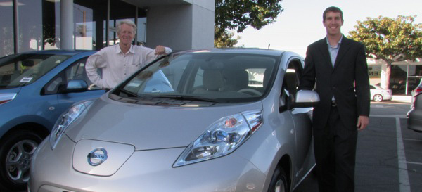 Tim Goodrich, right, stands next to his new electric car with founding member of Plug in America, Paul Scott | Photo via Tim Goodrich