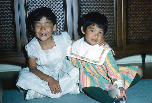 Me with my younger sister, back in the day. | Image: George Chong / My sister and I enjoying an evening at home.<br />