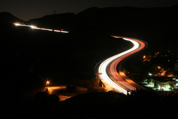 Vehicles zoom up and down the Conejo Grade in Ventura County at night.