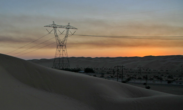 Transmission lines in the Desert | Creative Commons photo by Parker Michael Knight