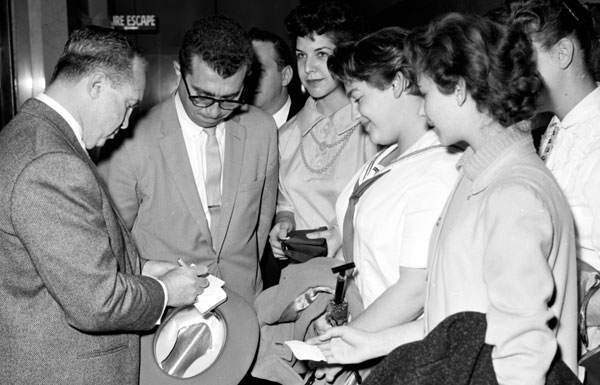 Cohen signs autographs for young women from Washington High School during a 1958 trial. Courtesy of the Los Angeles Examiner Collection, USC Libraries.