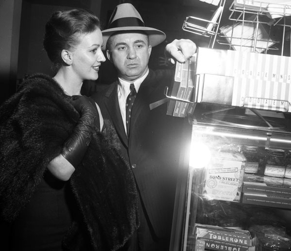 Cohen with Barbara Darnell, whom the Los Angeles Examiner identified as Cohen's 'secretary and sometimes girl friend,' in 1958. Courtesy of the Los Angeles Examiner Collection, USC Libraries.