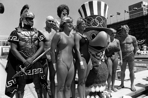 Ronald McDonald, Tommy Trojan, and Sam the Olympic eagle joined USC athletes in dedicating the McDonald's Swim Stadium. Courtesy of the David L. Wolper Center, USC Libraries.