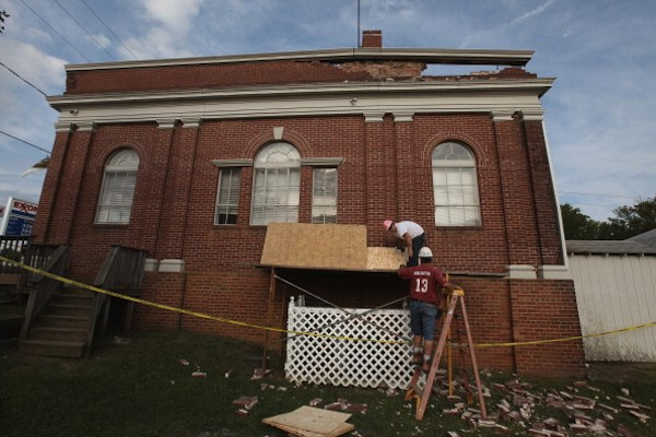 Workers begin repairs on the City Hall building, which is also the local DMV office, after the building was damged by Tuesday's 5.8 earthquake in Mineral, Virginia. (Photo by Scott Olson/Getty Images)