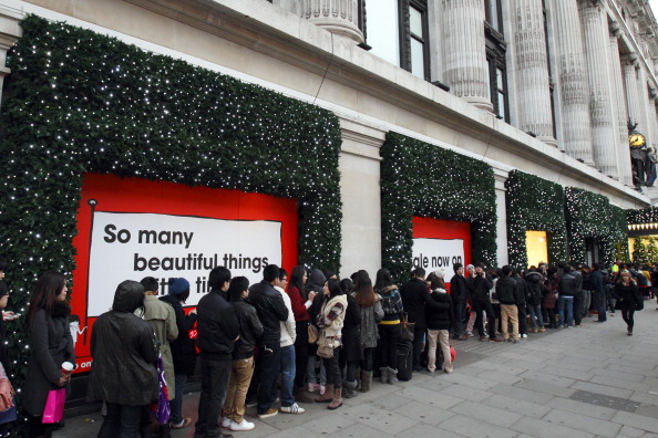 Long Christmas shopping lines, seen here in London, is ubiquitous. Inglewood, CA is no different. | JUSTIN TALLIS/AFP/Getty Images