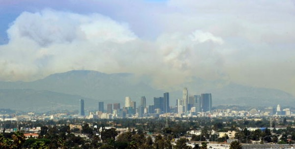 A wide plume of smoke from wildfires burning in the Angeles National Forest is seen from downtown Los Angeles during the Station Fire | Photo by Kevork Djansezian/Getty Images