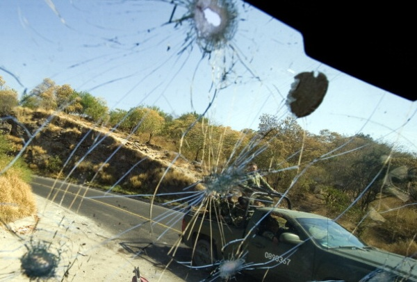 Mexican Army seen through the bullet-riddled windshield of a truck in Apatzingan, Michoacan State, Mexico, on December 12, 2010, a product of an apparent confrontation between Federal Police and a a cartel. | ALFREDO ESTRELLA/AFP/Getty Images