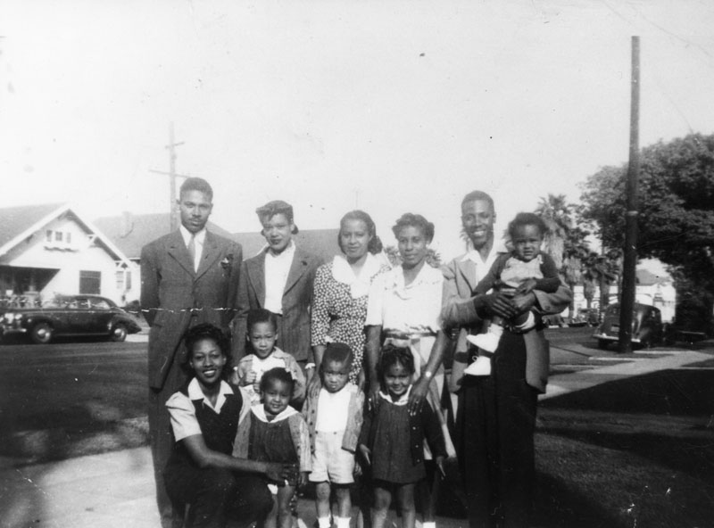 The Lee family in front yard of home near Central Avenue and 21st Street.