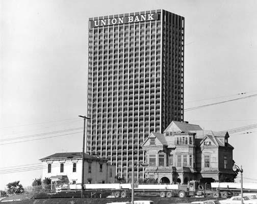 Union Bank Square rises behind the Castle and the Salt Box, two of the last remnants of Victorian-era Bunker Hill, in 1966