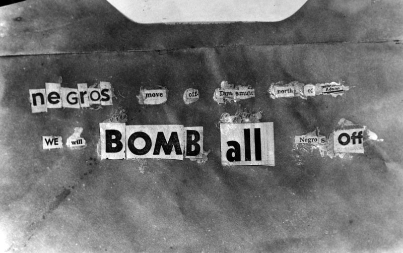 """Copy of the note that was found at the William Bailey home at 2130 South Dunsmuir Avenue, after it was bombed. The note reads, """"Negros move off Dunsmuir north of Adams we will bomb all negros off."""" Photograph dated March 17, 1952. 