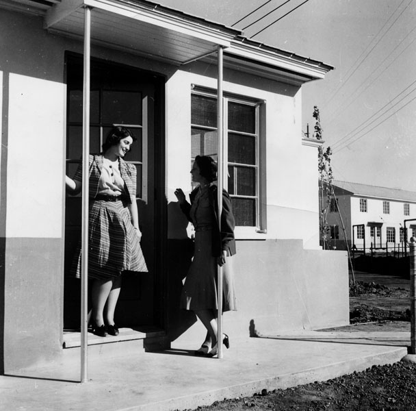 Muriel Robbins, left, and Mildred Davis, right, of the tenant selection staff of the County Housing Authority, talk over the opening of the Carmelitos low-rent housing project, located at 5150 Atlantic Boulevard, in North Long Beach. 1940. | Los Angeles P