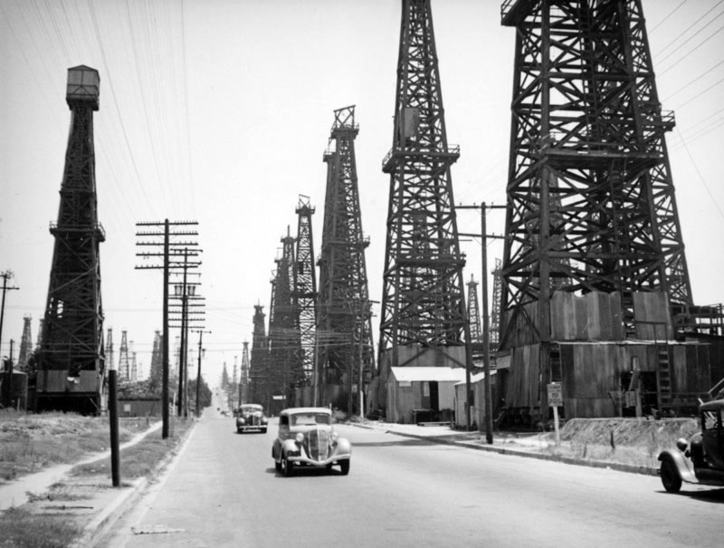 Driving through a forest of derricks in Signal Hill. Circa 1937 photo by Herman Schultheis, courtesy of the Photo Collection - Los Angeles Public Library.