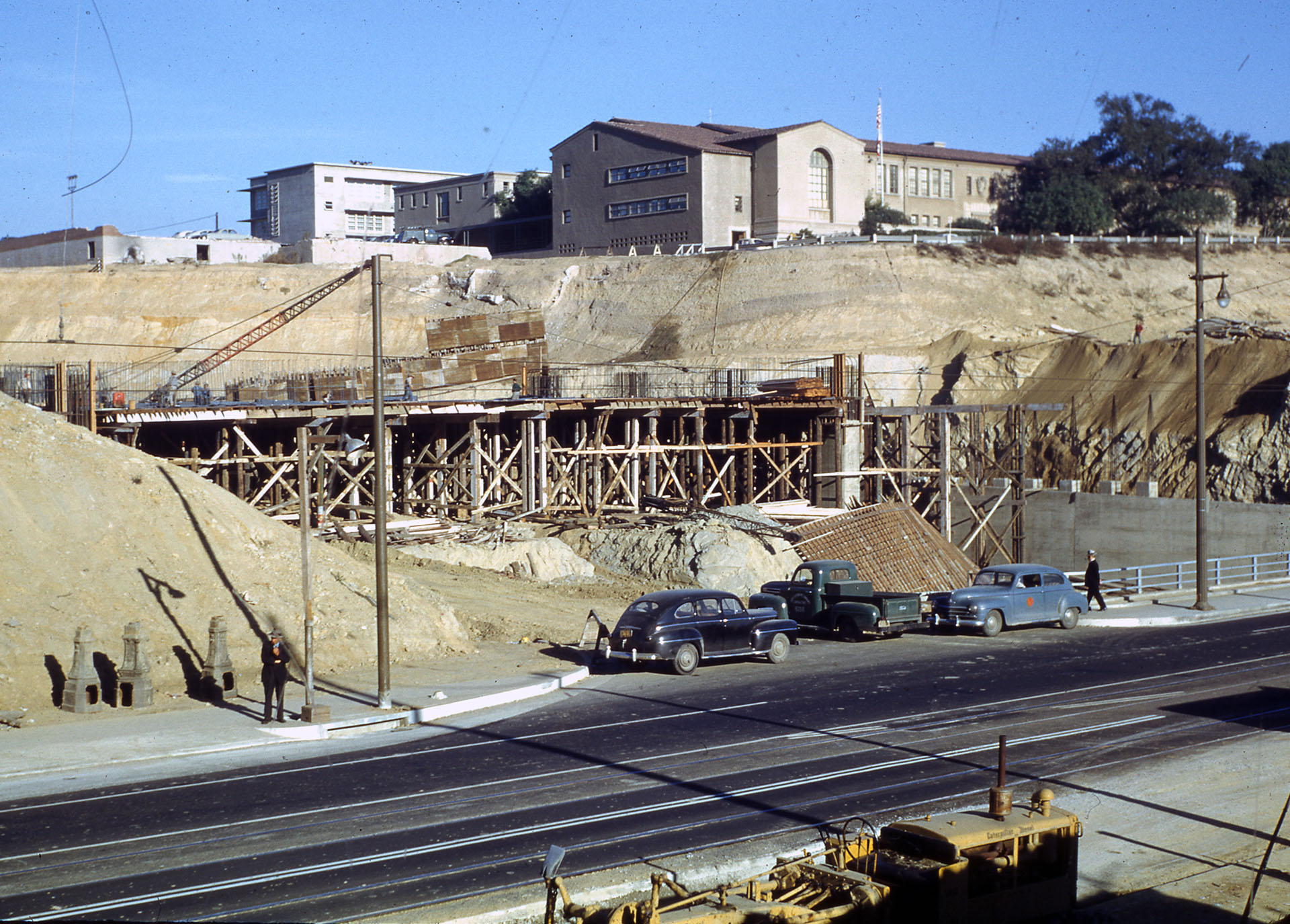 Construction of the Hollywood and Harbor freeways required crews to cut artificial canyons through Fort Moore and Bunker Hills. Courtesy of the Herald-Examiner Collection - Los Angeles Public Library.