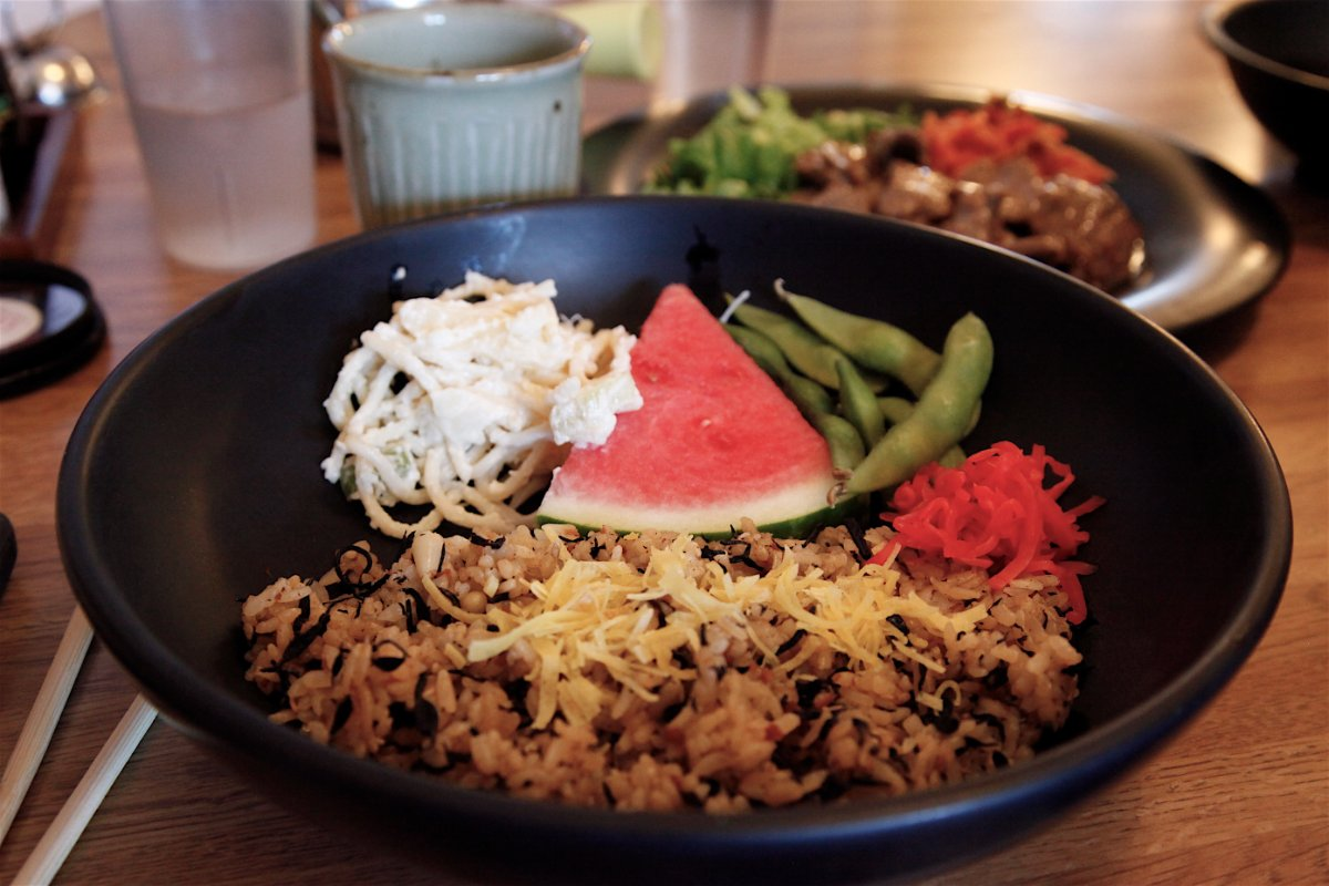 Served with Kalbi Beef plate - steamed rice, pasta salad, a piece of watermelon, green beans, carrot & shredded cabbage.  Steamed rice replaced with hijiki seaweed rice for $2 | Mariko Lochridge
