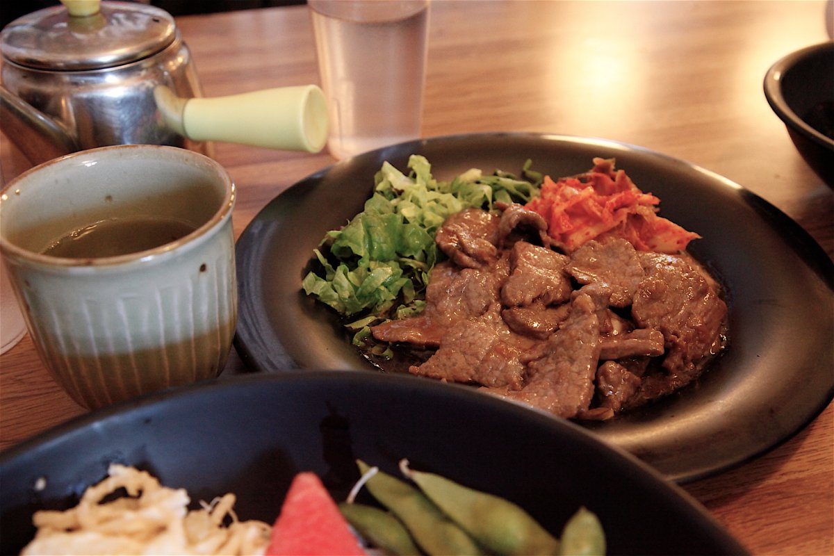 Kalbi Beef plate (no bone) with kimchee, sesame seed, sesame oil and salad. | Mariko Lochridge