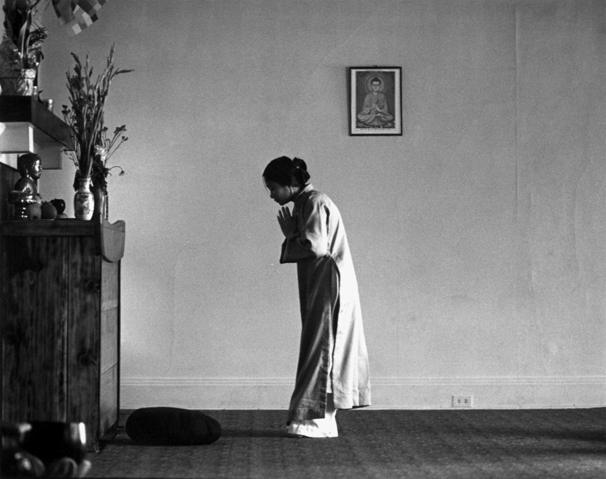 Woman Praying at the Vietnamese Buddhist Temple, Los Angeles by Don Farber, 1977 | Don Farber