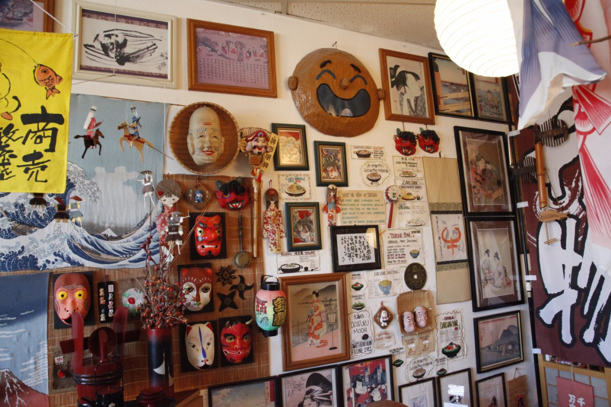 Wall to the left as you enter. Daichan's walls are full of decorations old and new, gifted, purchased and handmade.  Yoshi claims to know the backstory and location of every single piece. | Mariko Lochridge