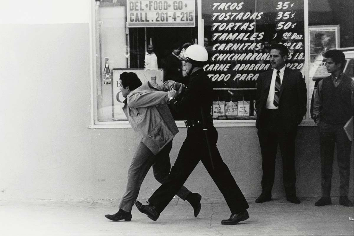 George Rodriguez, LAPD arresting a Chicano student protester, Boyle Heights , 1970. | Courtesy of the artist.