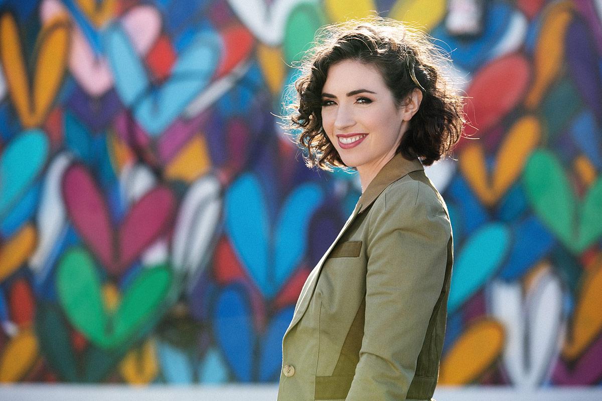 Jennifer Rosenfeld poses in front of a colorful wall. | Courtesy of Jennifer Rosenfeld