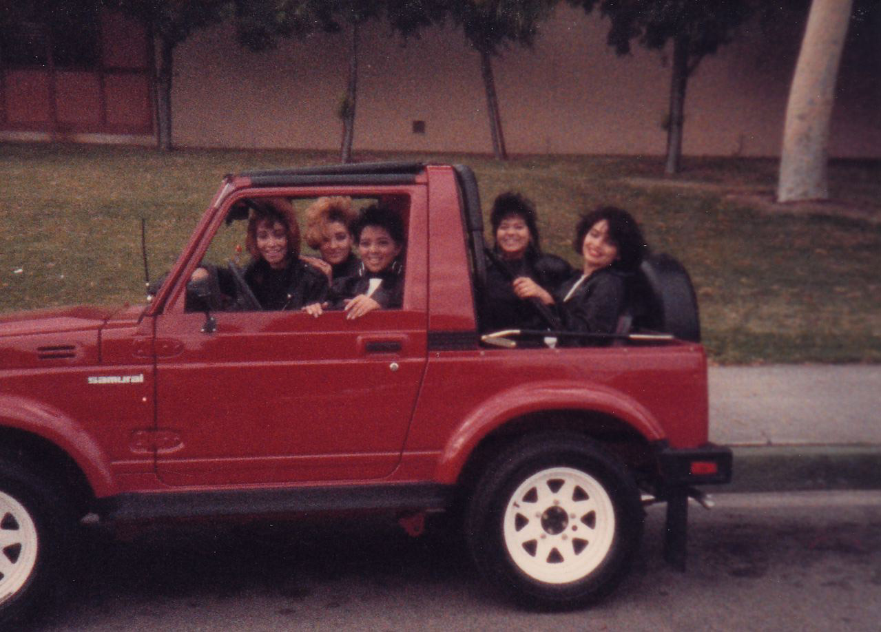 """Divine Dolls Irma, Gigi, Judy, Karen and Maryann in a Suzuki"
