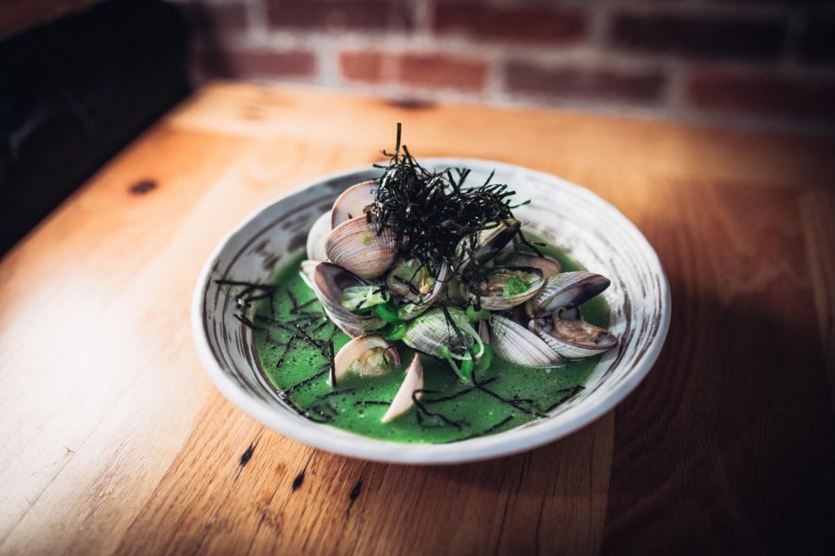 Tsubaki's Asari Saka-Mushi: Sake-steamed Baja clams, green garlic dashi | Courtesy of Life & Thyme