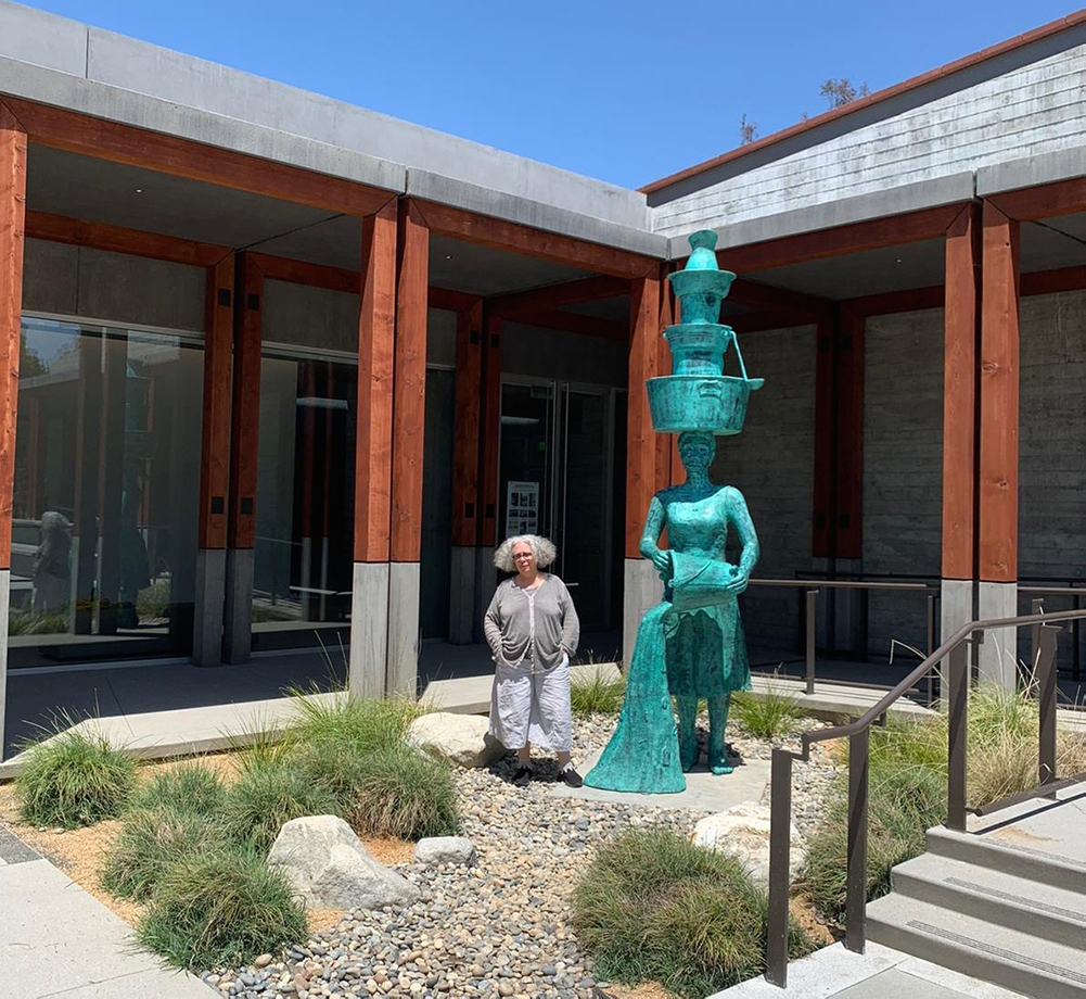 "Alison Saar next to ""Imbue"" (2020) outside the Benton Museum of Art 