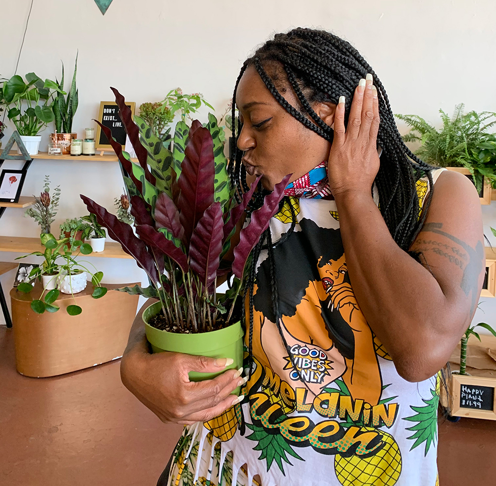 A woman kissing her beloved plant | Courtesy of Plants and Teas