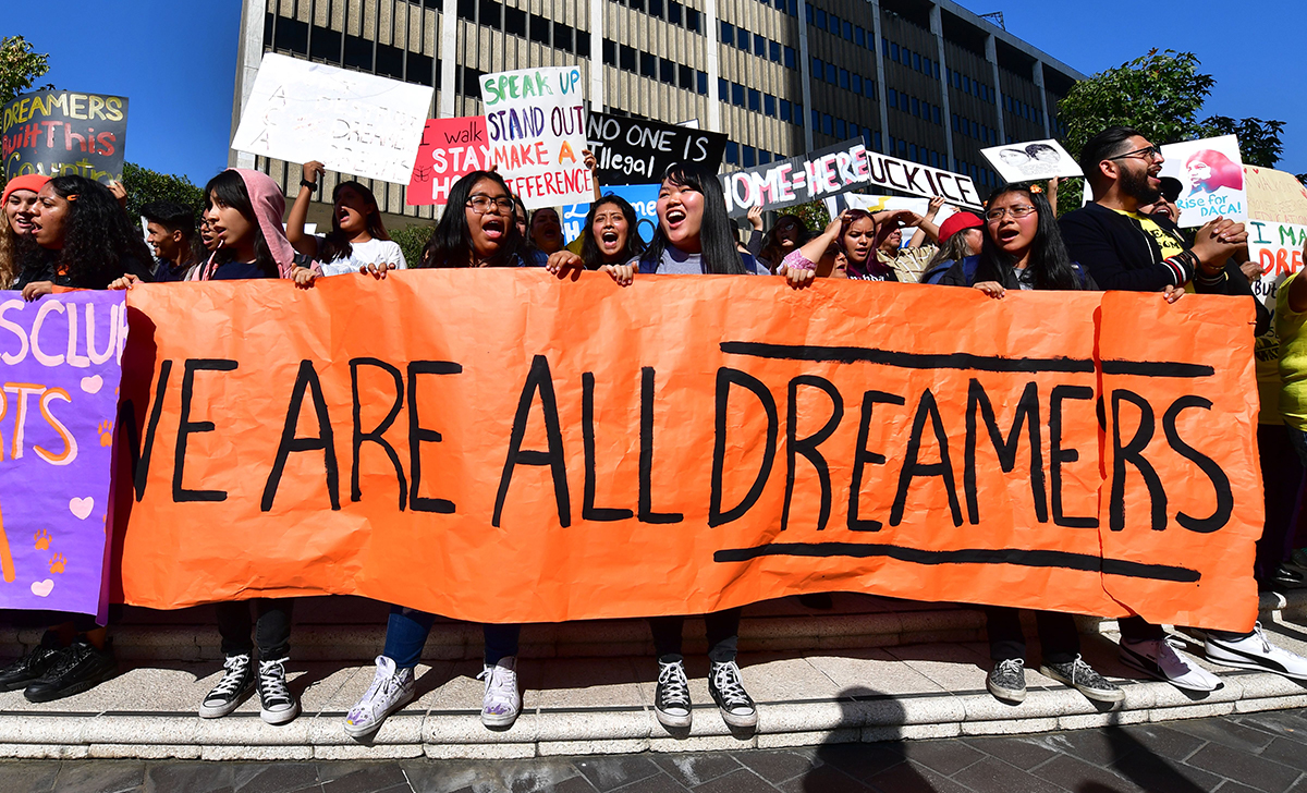 """Students and supporters of DACA rally in downtown Los Angeles, California on November 12, 2019 as the US Supreme Court hears arguments to make a decision regarding the future of """"Dreamers."""" 