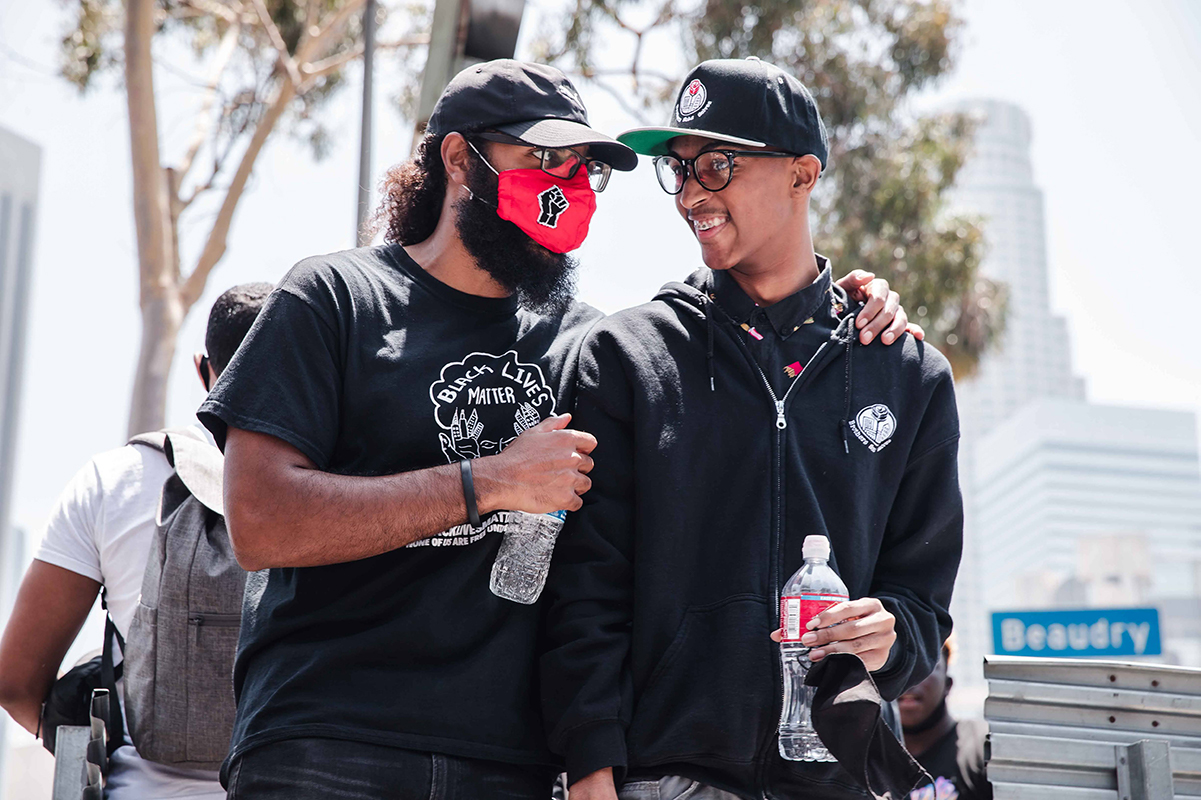 Joseph Williams of  at Students Deserve and Core Leader with Black Lives Matter  talks with Christian Wimberly, youth leader with the Brotherhood Crusade and the Brothers Sons Selves Coalition | Courtesy of Brothers, Sons, Selves