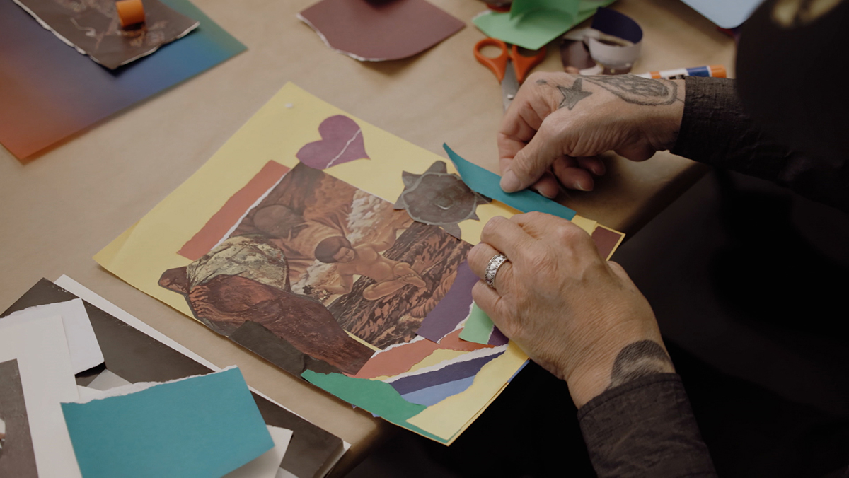 """A person making a collage artwork  