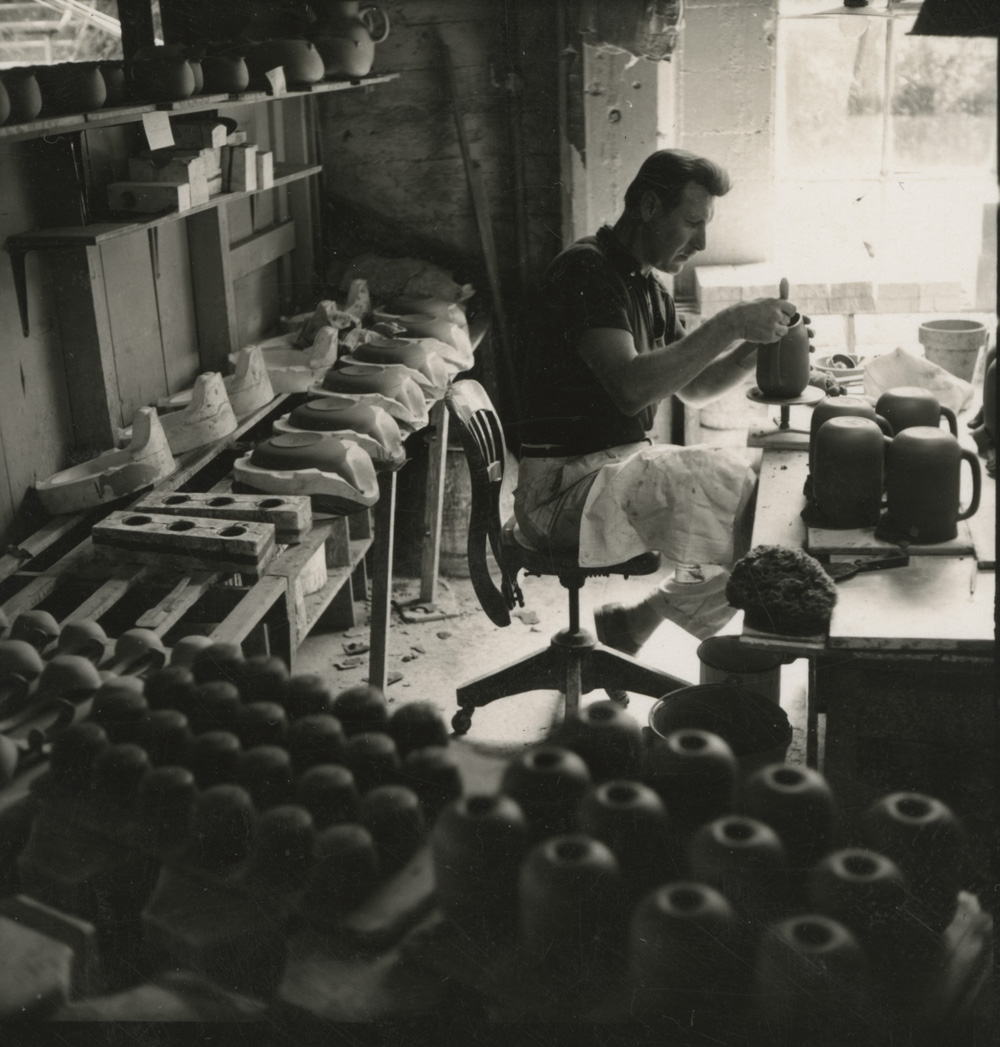 Man makes cups in Heath factory. | Courtesy of the Environmental Design Archives at UC Berkeley