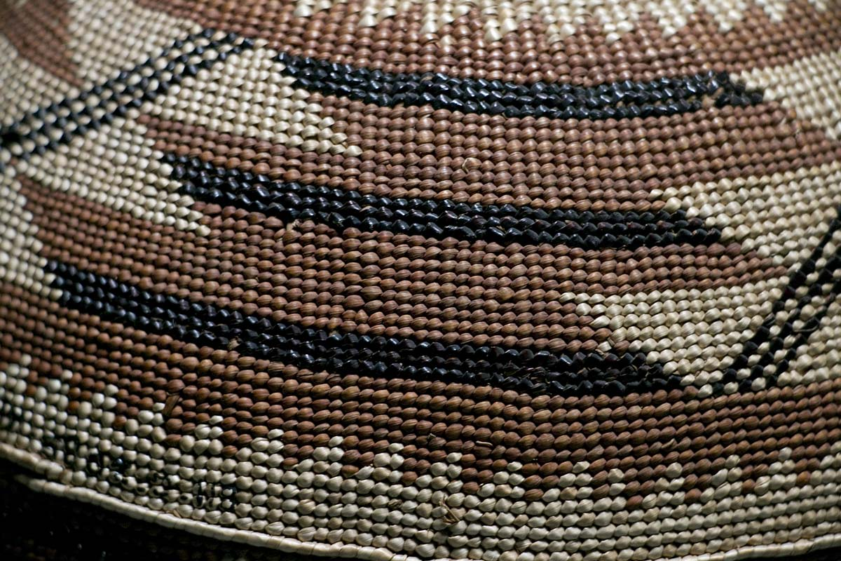 Detail of Karuk basket cap made of conifer root, beargrass, maidenhair fern, and red-dyed woodwardia fern, Autry Museum of the American West Collection | Carren Jao