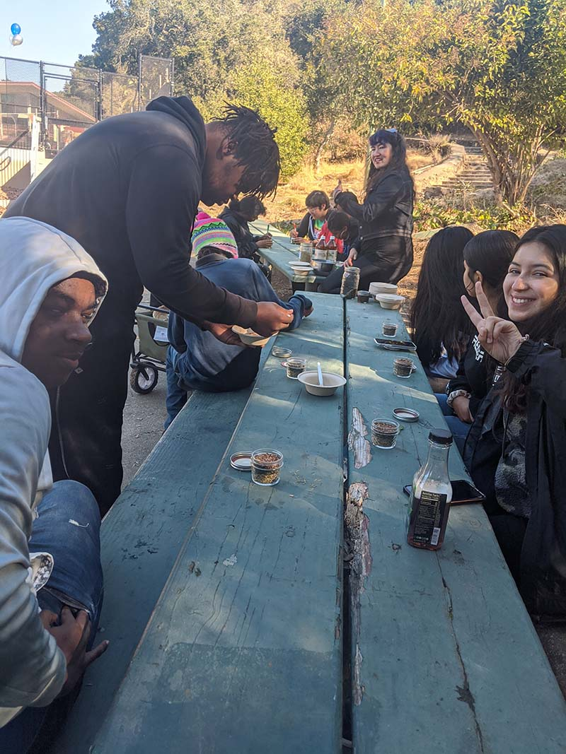 Californians for Justice leaders in a workshop learning about healing remedies of plants and herbs. | Californians for Justice