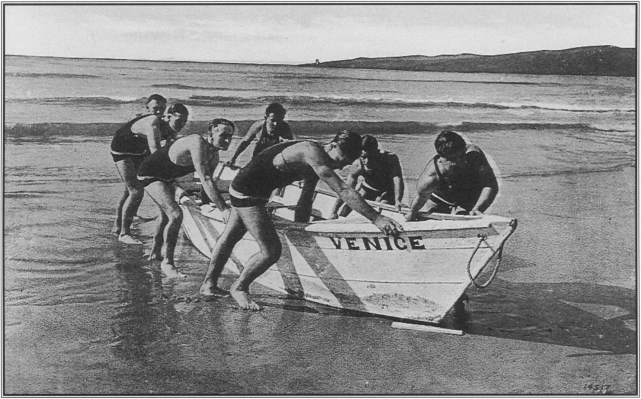 Launching and christening the Venice, the new lifeboat purchased for the Venice Volunteer Lifesaving Corps, was a public event of note. The following year, bringing in  the boat after a practice rowing session  was recorded on this 1908 postcard.