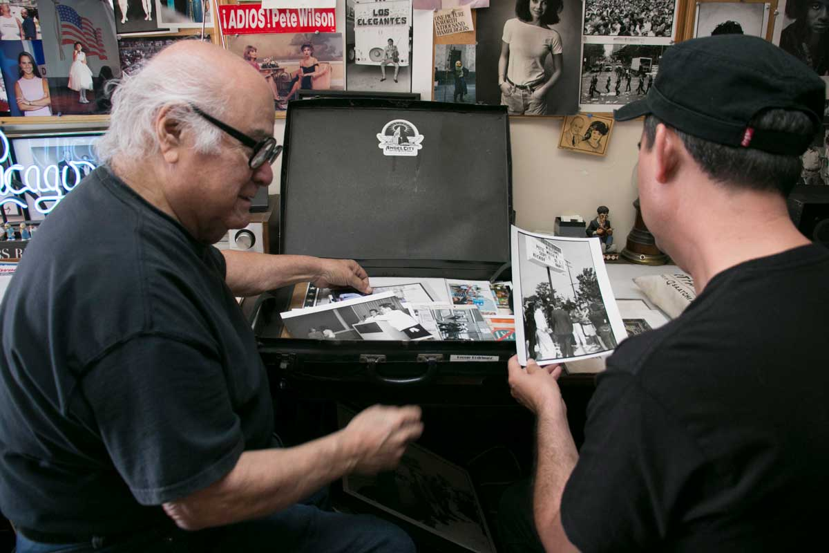 George Rodriguez showing his photographs over the years to filmmaker Omar Foglio | Carren Jao
