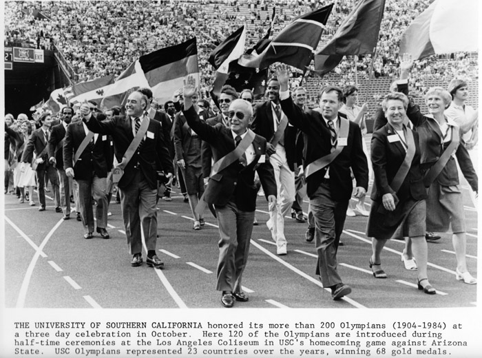 Lee marches with other USC Olympians in 1984