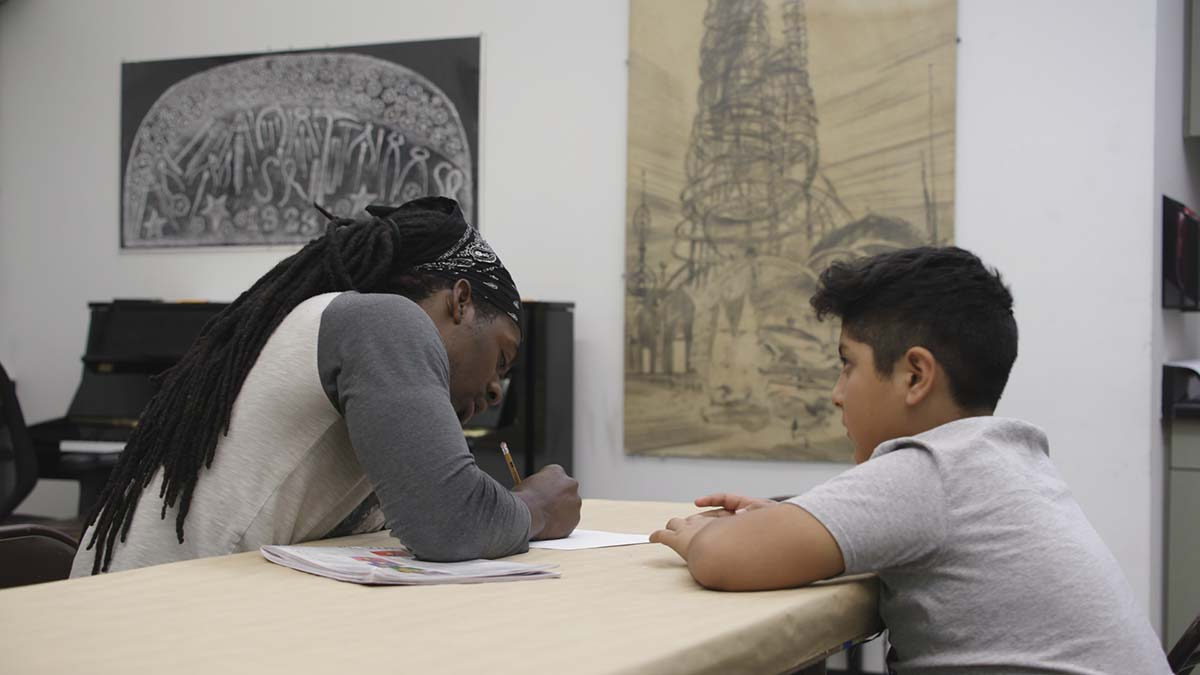 """A young man gets instruction on art at the Watts Towers Arts Center   Still from """"The Watts Towers Arts Center"""" ab s11"""