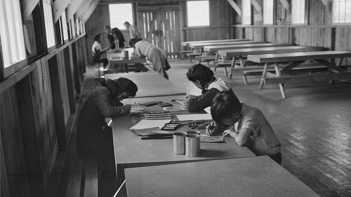Evacuee children are remaining after hours to continue their creative work. | Dorothea Lange, War Relocation Authority Photographs of Japanese-American Evacuation and Resettlement / National Archives  ABs10 MMD