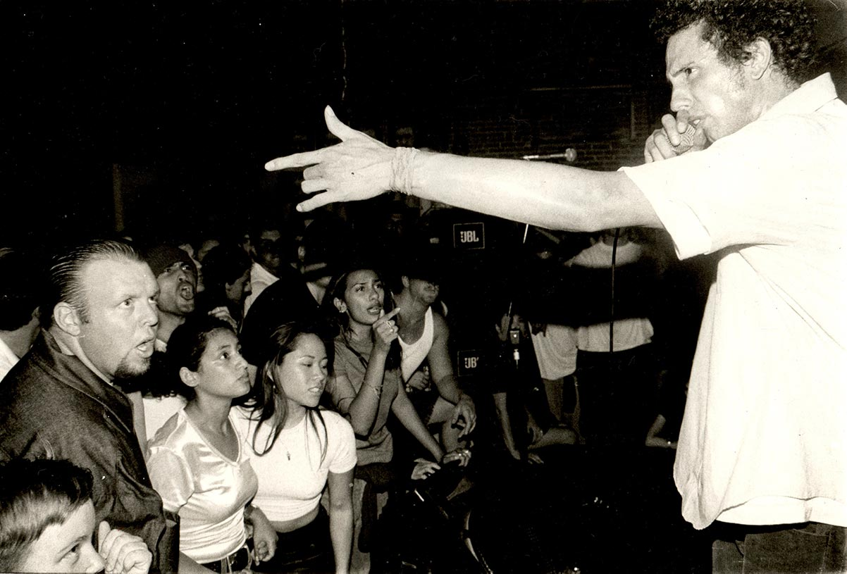 Zack de la Rocha and Rage Against the Machine Performing at In The Red: An Observance of Human Rights, Regeneracion / Popular Resource Center, 1995 | Antonio Garcia