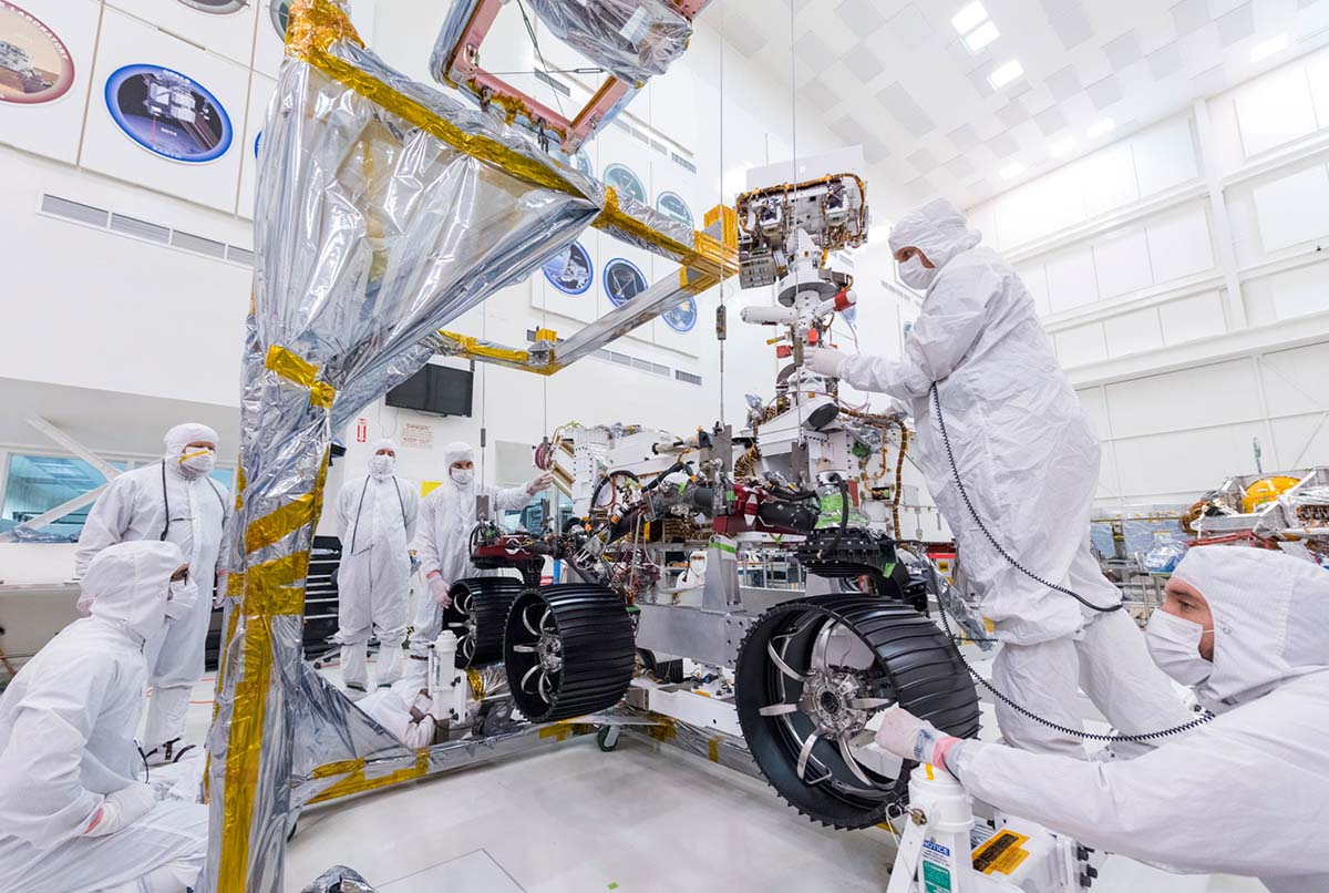 On June 13, 2019, engineers at JPL install the starboard legs and wheels — otherwise known as the mobility suspension — on the Mars 2020 rover | NASA/JPL-Caltech